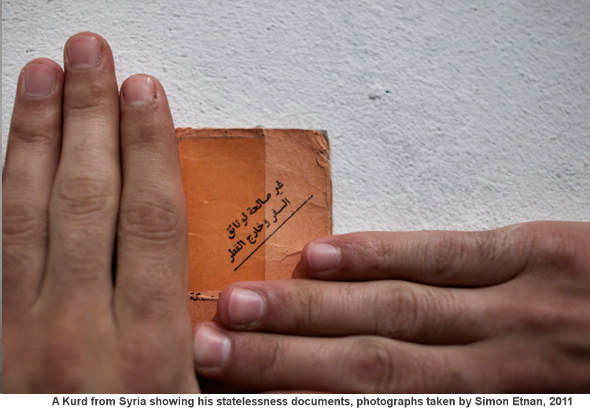 Stateless Syrian Kurd - Showing his documents
